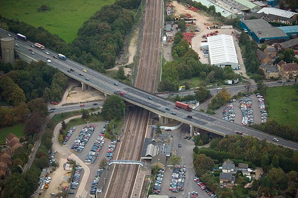 The A14 viaduct spans Brampton Road and the East Coast Main Line near Huntingdon Station