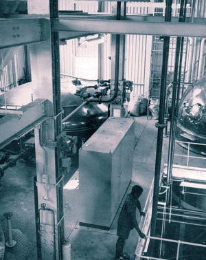 General view of the mash tun stage. Steelwork is extensively used to support the special brewing equipment.