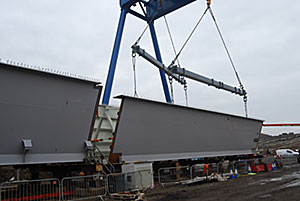 Girder sections are welded together onsite before being launched