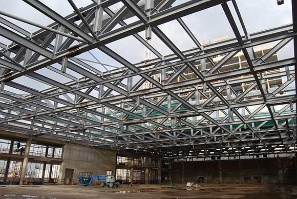 A series of steel trusses form the large open ballroom