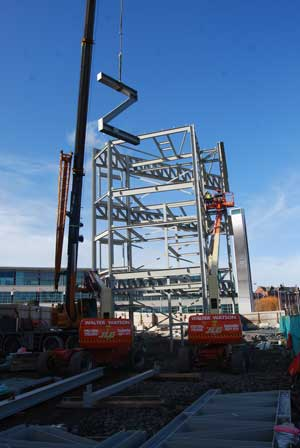 Z-shaped bracing is lifted into place