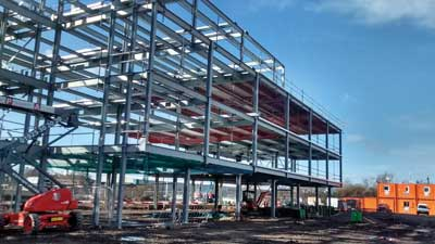 The steel frame nears completion