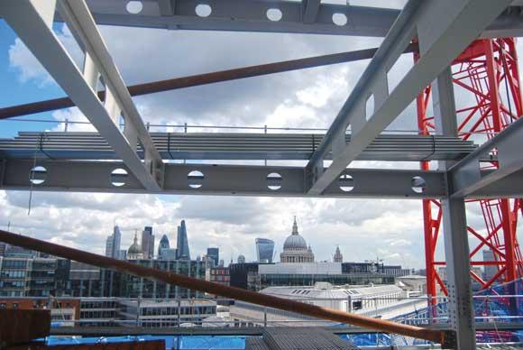 The upper office floors provide views across the City