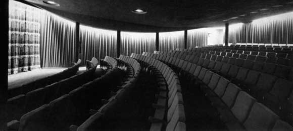 The auditorium seats 400 and was formerly the basement. Particularly noticeable is the three dimensionally curved ceiling of anti-clastic profile enabling the use of beams of small depth