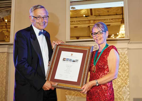 Roger Pope receives his Fellowship from Wendy Coney