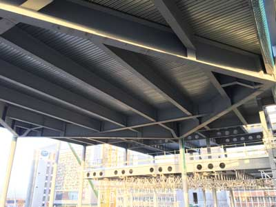 A bespoke steelwork grillage supports a rooftop garden