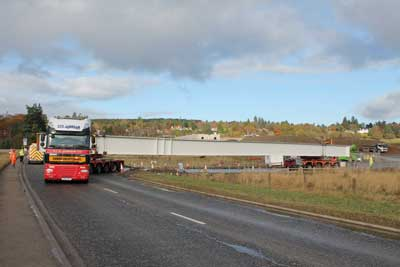 One of the 46m-long girders for the North Deeside Overbridge is delivered