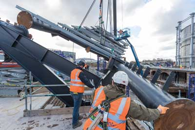 Eight individual and bespoke truss sections are lifted into place