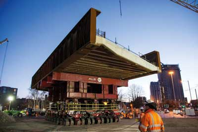 One of the Water Street bridges is transported to its final position