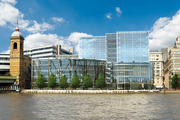 Riverside development rises beside the ThamesR
