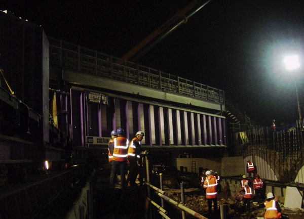 Steel bridge installed safely over live railway