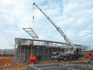 Ladder sections for the roof are lifted into place