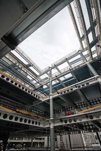 The building's large open plan floorplates wrap around the atrium