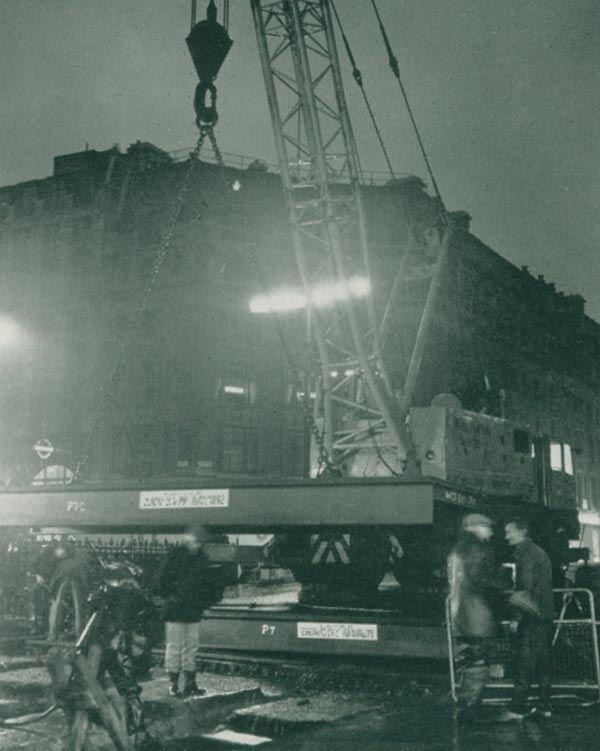 August 3rd, midnight; Gangs on round-the-clock  12-hour shifts erect 600 tons of steel in 46½ hours