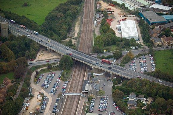 The A14 viaduct spans Brampton Road and the East Coast Main Line near Huntingdon Station