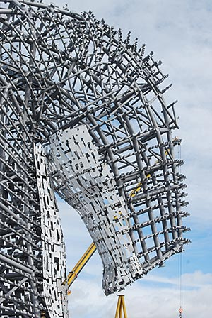 Each head is formed from more than 13,000 invididual steel pieces