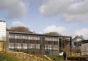 The side elevation is clad with brise soleil