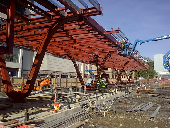 Feature columns drive bus station project
