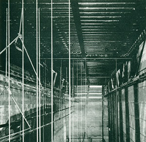 Below: Backstage trusses showing bolted connections, stage grid supporting scenery and backcloth, vertical joists forming rear wall.