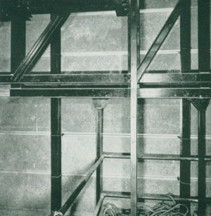 Detail backstage showing rear truss, fly gallery, stage grid and vertical joists.