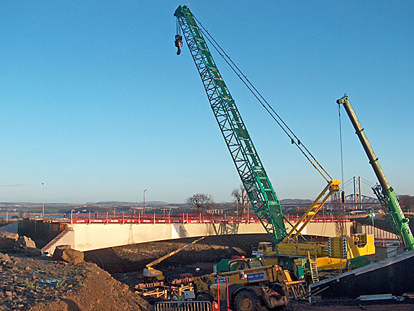 One of the bridges for the new south shore approach interchange is lifted into place