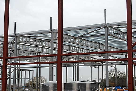 The Waitrose store steelwork seen through the leisure centre's frame