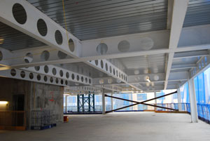 The structure features clear open plan office spaces
