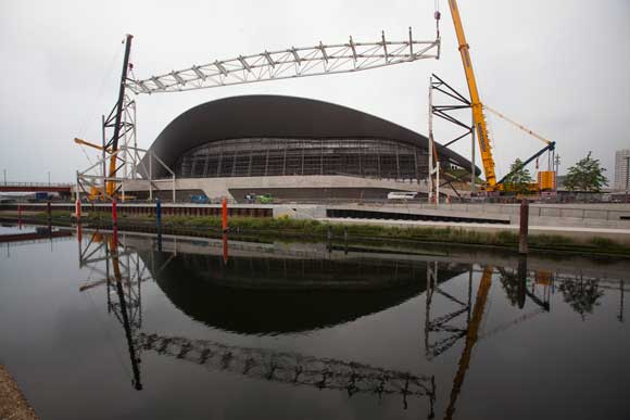 A large truss, which formerly supported temporary seating, is removed as part of the venue's reconfiguration