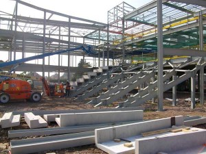 Steel rakers form the seating areas for the drama hall