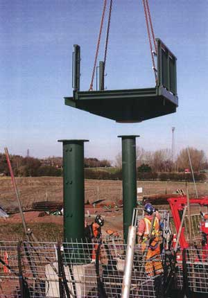 A prefabricated unit is lifted into place