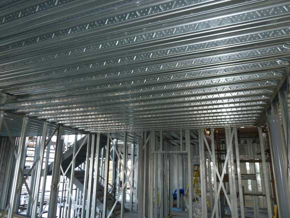 Composite decking supported on light steel walls