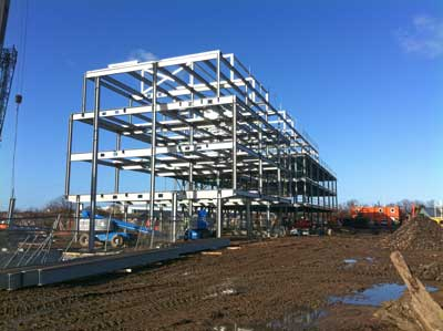 The steel frame is supported on piled foundations