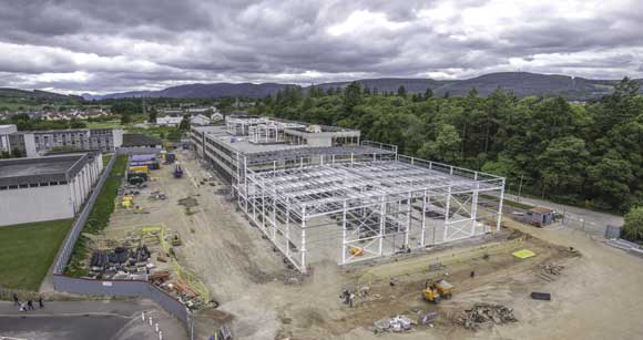 The steel frame will house two sports halls