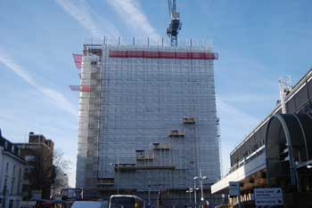 Sheeting encloses the tower as the new floors are erected