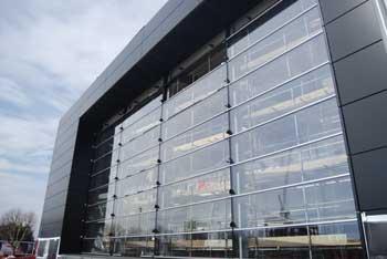 The glazed façade of the visitor centre