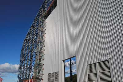 Cladding proceeds on the main process building