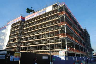 Scaffolding has been erected to allow the installation of the cladding system