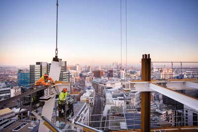 No time to take in the view as steel erectors complete a bolted connection