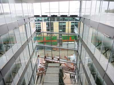 A full-height atrium splits the building in half