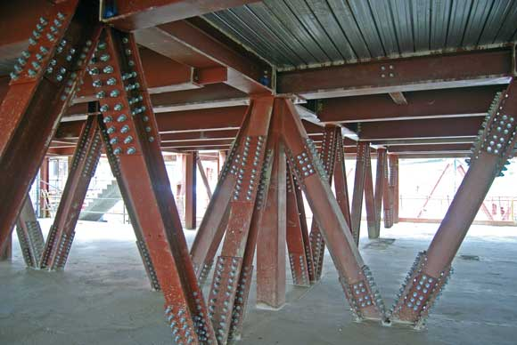 Trusses support the rooftop apartments