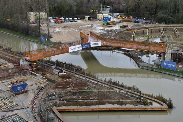 Three-legged bridge for canalside marina